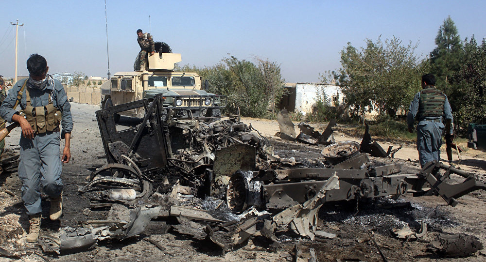 Afghan security forces inspect the site of a U.S. airstrike in Kunduz city, north of Kabul, Afghanistan (File)
