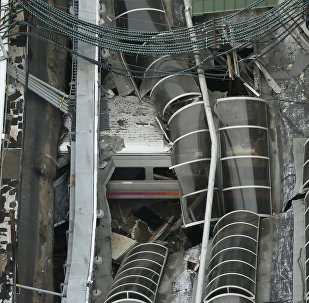 A derailed New Jersey Transit train is seen under a collapsed roof after it derailed and crashed into the station in Hoboken, New Jersey, U.S. September 29, 2016