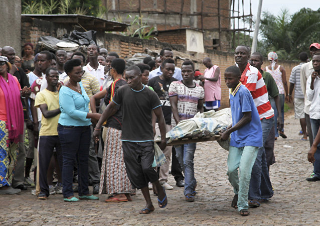 Men carry away a dead body in the Nyakabiga neighborhood of Bujumbura, Burundi (File)