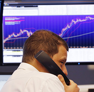 A trader makes a telephone call at the stock market in Frankfurt, Germany (File)