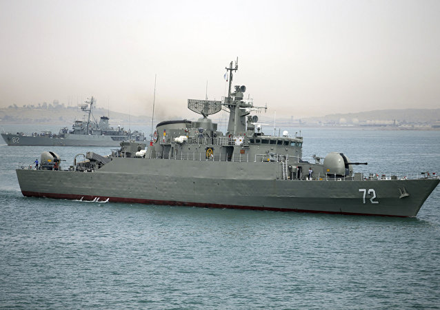 Iranian warship Alborz, foreground, prepares before leaving Iran's waters (File)