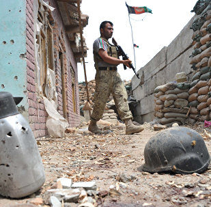 An Afghan security serviceman keep watch at a damaged police post following an airstrike in Bati Kot district in Nangarhar province (File)