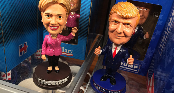 Bobblehead dolls depicting Democratic presidential nominee Hillary Clinton and her Republican counterpart Donald Trump are seen Septmber 29, 2016 at Ronald Reagan National Airport in Arlington, Virginia