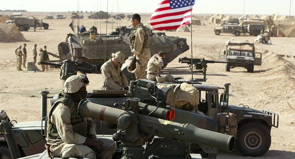 American marines of the USMC (US Marine Corps) put a flag on a antenna of a HMMWI (Hight Mobility Multi Wheeled Vehicles) in the north of the desert Kuwait near the Iraqi border 15 March 2003