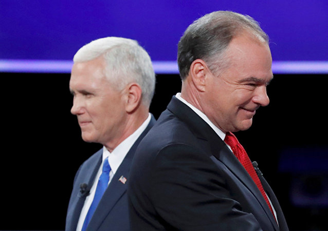 Democratic U.S. vice presidential nominee Senator Tim Kaine and Republican U.S. vice presidential nominee Governor Mike Pence (L) pass each other after the conclusion of their vice presidential debate at Longwood University in Farmville, Virginia, U.S., October 4, 2016.