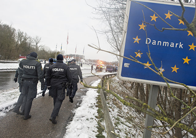 Police officers walk at the Danish-German border in Krusaa, Denmark