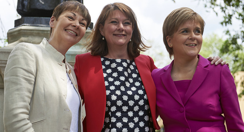 Scottish First Minister and Leader of the SNP, Nicola Sturgeon (R) poses with Plaid Cymru leader Leanne Wood (C) and Former leader of The Green Party, Caroline Lucas pose during a photo call in central London on May 23, 2016.