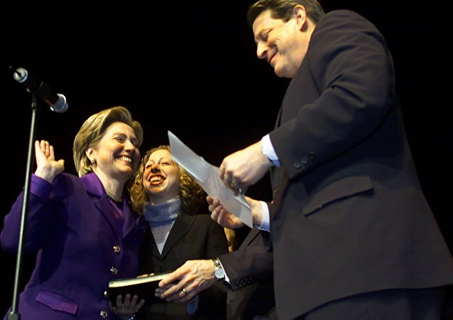 Sen. Hillary Rodham Clinton laughs with her daughter Chelsea during a mock swearing-in with Vice President Al Gore at the New York State Democratic Committee Tribute to Senator Clinton, celebrating her U.S. Senate seat Sunday, Jan. 7, 2001, at Madison Square Garden, in New York City.