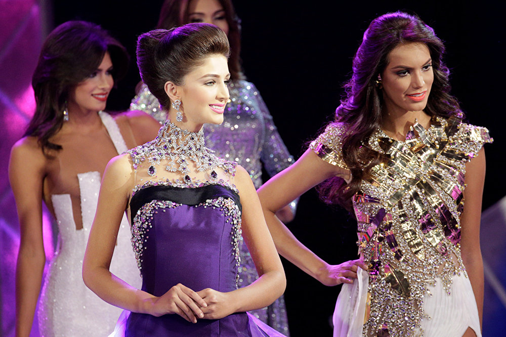 Contestants compete during the evening gown segment of the Miss Venezuela 2016 pageant in Caracas, Venezuela October 5, 2016.