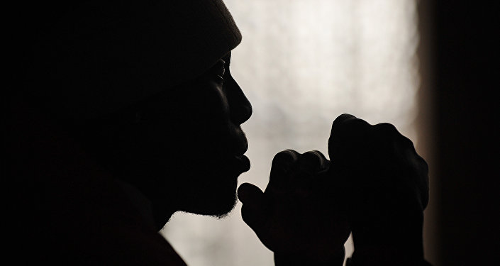 Former gang member Tayo Shodunke attends a mentoring session at St Paul's church in east London, on August 17, 2011.