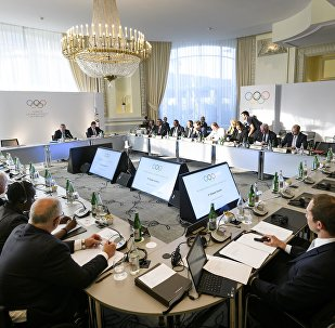 Members take their seat for the opening of an Olympic Summit on reforming the anti-doping system on October 8, 2016 in Lausanne