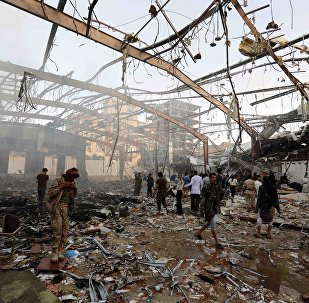 People inspect the aftermath of a Saudi-led coalition airstrike in Sanaa, Yemen, Saturday, Oct. 8, 2016