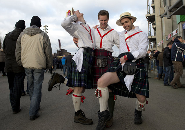 Scotland fans in kilts strike a pose before the start of the Six Nations international rugby union match between England and Scotland at Twickenham Stadium in south-west London on February 2, 2013.