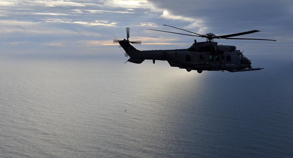 This picture taken on February 24, 2016, shows a French Caracal helicopter flying offshore during an air-to-air refuelling exercise.
