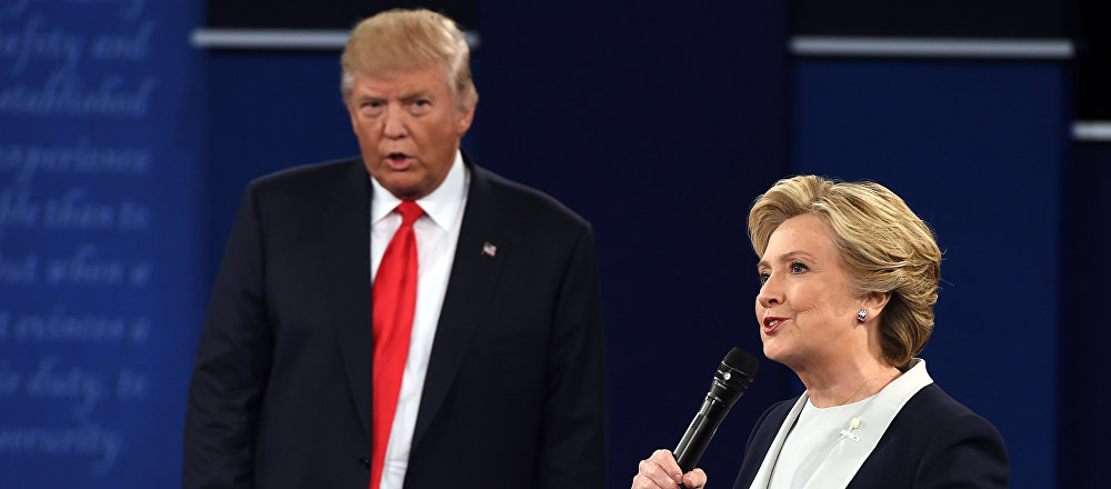 US Democratic presidential candidate Hillary Clinton and US Republican presidential candidate Donald Trump debate during the second presidential debate at Washington University in St. Louis, Missouri, on October 9, 2016