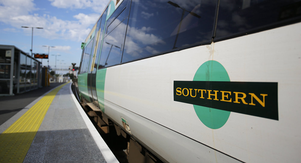 A Southern Rail logo is pictured on the side of a train carriage as t stands at a platform at East Croydon station, south of London