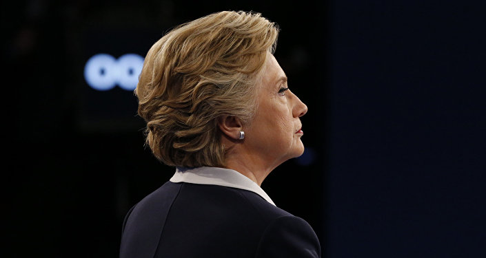 Democratic presidential nominee Hillary Clinton looks on during the second presidential debate at Washington University in St. Louis, Missouri on October 9, 2016.