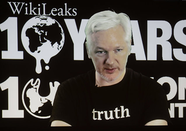 In this Oct. 4, 2016 file photo, WikiLeaks founder Julian Assange participates via video link at a news conference marking the 10th anniversary of the secrecy-spilling group in Berlin. WikiLeaks said on Monday, Oct. 17, 2016, that Assange's internet access has been cut by an unidentified state actor.