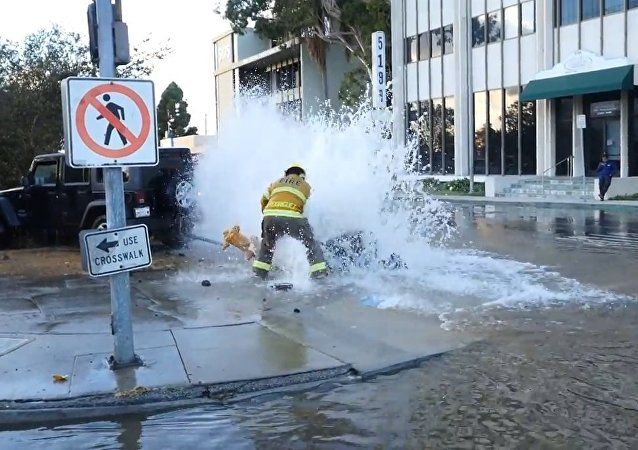 Jeep hits fire hydrant, I come just in time to catch the fireman getting it shut off