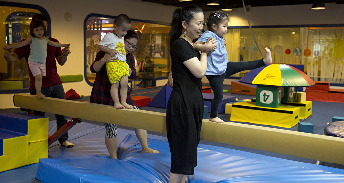 Children are guided by their parents during classes at the Inspire Sports private gym in Shanghai, China. (File)