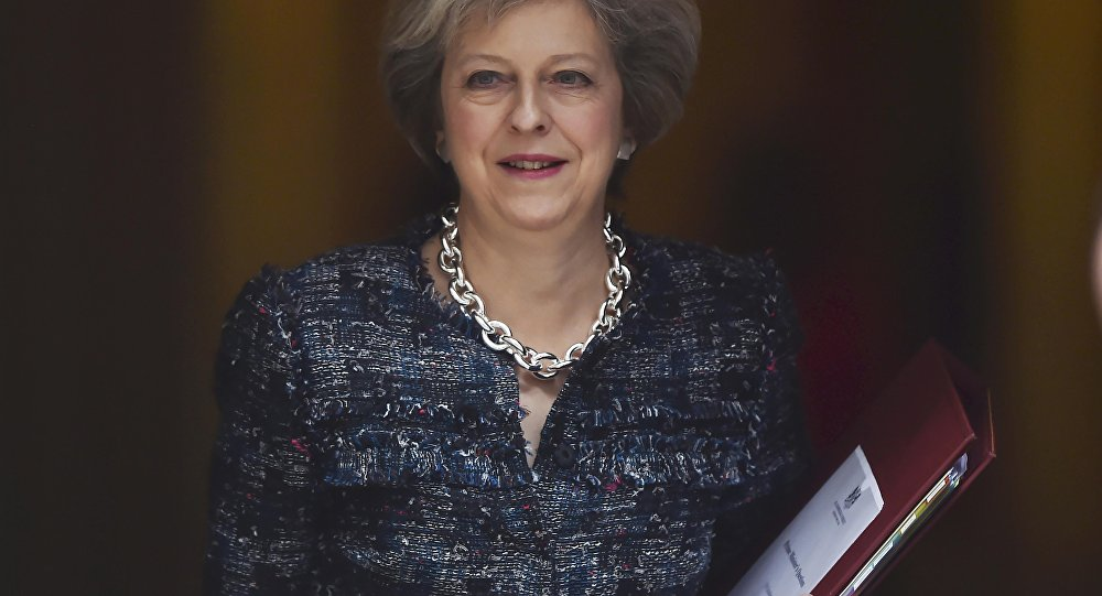 Britain's Prime Minister Theresa May leaves Number 10 Downing Street to attend Prime Minister's Questions at parliament in London, Britain October 19, 2016.