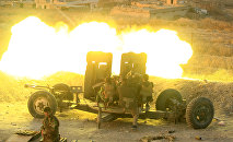 Peshmerga forces fire an anti-aircraft gun towards Islamic state militants positions in the town of Naweran near Mosul, Iraq, October 20, 2016.