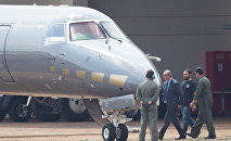 The former president of the Chamber of Deputies Eduardo Cunha, is escorted to a Federal Police's plane, departing to Curitiba where he should fulfill his provisionally arrest, which was issued this morning, at the Hangar of the Federal Police in Brasilia