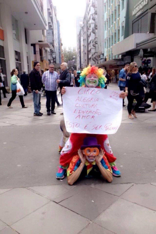 Clowns participating in the protest in the center of Porto Alegre