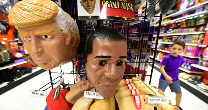 A child walks past a display of masks of US President Barack Obama, and presidential hopefuls Donald Trump and Hillary Clinton, for sale at a shop selling Halloween items in Alhambra, California on October 21, 2016