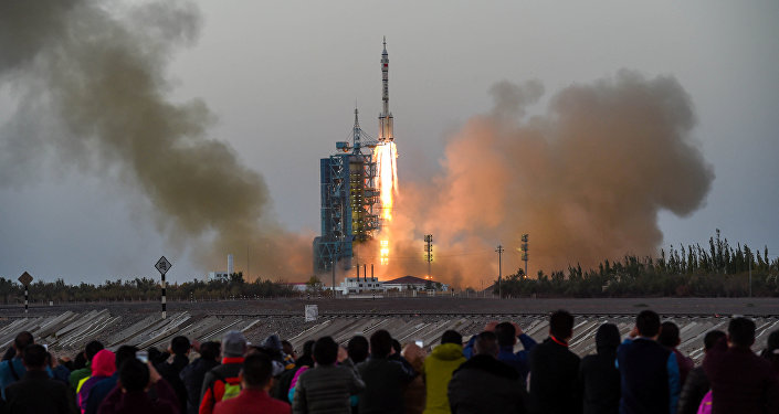 Shenzhou-11 manned spacecraft carrying astronauts Jing Haipeng and Chen Dong blasts off from the launchpad in Jiuquan, China, October 17, 2016