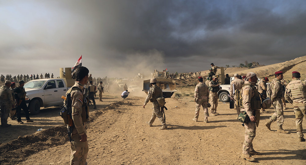 Iraqi army soldiers wait for an attack to begin against the Islamic State group of Mosul, Iraq, Thursday, Oct. 20, 2016