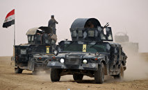 Iraqi forces gather in the al-Shura area, south of Mosul, on October 24, 2016, during an operation to retake the main hub city from the Islamic State (IS) group jihadists