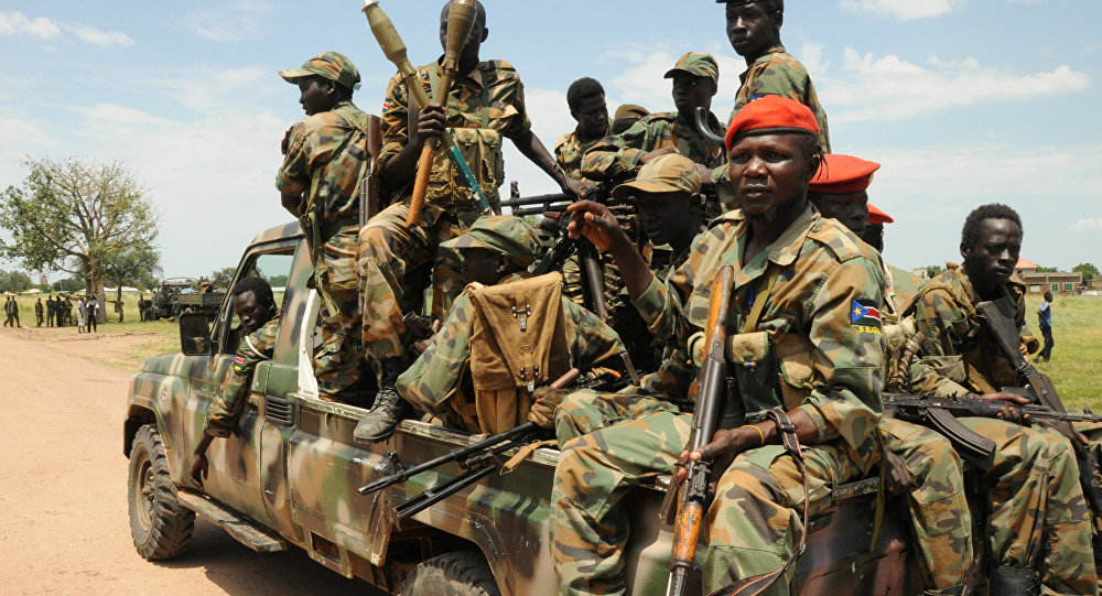 Sudan People's Liberation Army (SPLA) forces patrol the camp of Lalo following heavy fighting over the weekend that killed dozens of people, close to Malakal, South Sudan, October 16, 2016