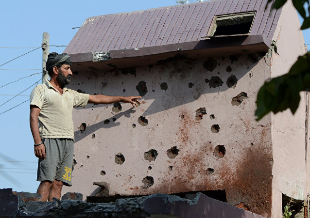 An Indian resident of Gajansoo border village points out damage to property from cross border firing in Kanachak sector, about 25km from Jammu, on October 24, 2016