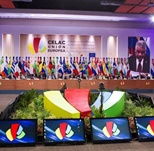 Dominican Foreign Minister Miguel Vargas Maldonado (on screens) delivers a speech during the opening of the XLVIII Senior Officials Meeting of the Community of Latin American and Caribbean States (CELAC) and the European Union (EU) in Santo Domingo, on October 24, 2016