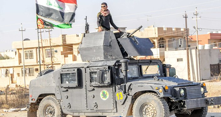 A Yazidi fighter taking part in the Iraqi army's operation to liberate Mosul