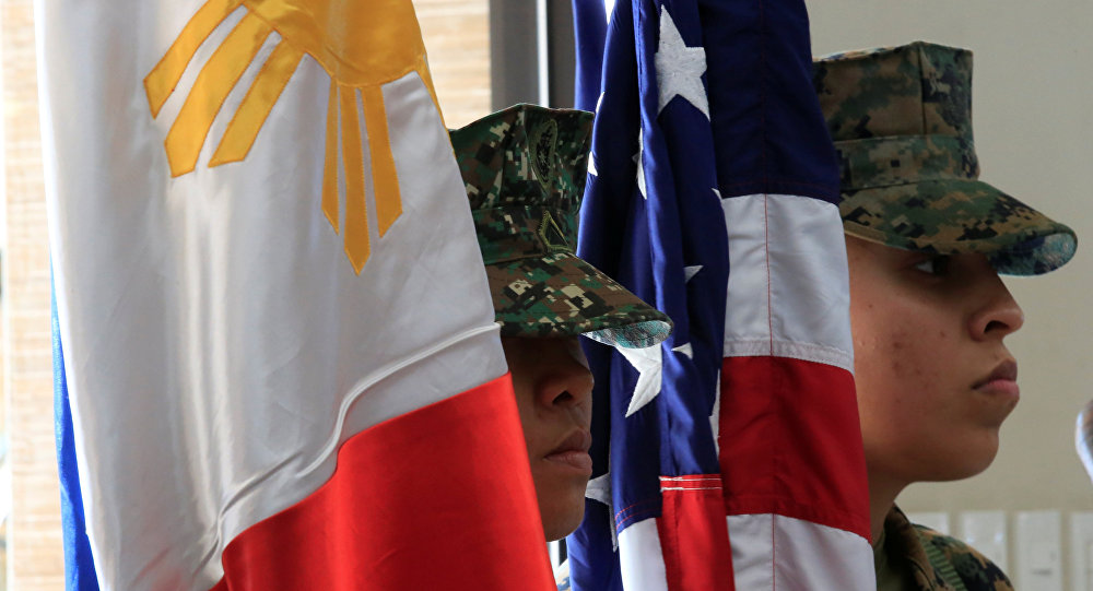 Members of the Philippine-US marine corps stand at attention with the Philippine and American flags during the Philippines-US amphibious landing exercise (PHIBLEX) closing ceremony inside the Philippine Marines headquarters in Taguig city, metro Manila, Philippines October 11, 2016