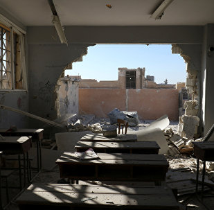 A damaged classroom is pictured in Hass, south of Idlib province, Syria