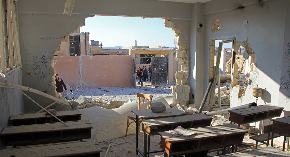 A general view shows a damaged classroom at a school after it was hit in an air strike in the village of Hass, in the south of Syria's rebel-held Idlib province on October 26, 2016.