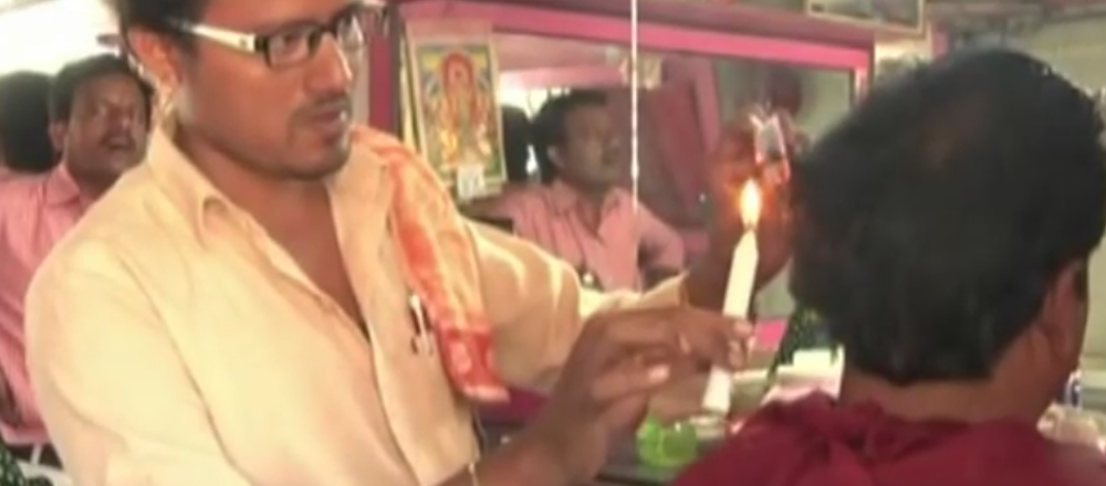 Barber uses candles for haircuts