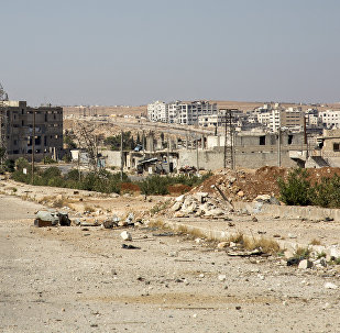 A general view shows a damaged road and abandoned buildings in Aleppo's rebel-held Kalasa neighbourhood