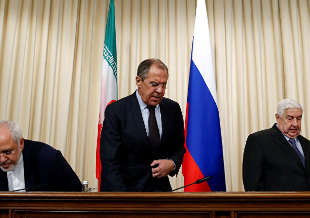 Russian Foreign Minister Sergei Lavrov (C), Syrian Foreign Minister Walid al-Muallem (R) and Iranian Foreign Minister Mohammad Javad Zarif attend a news conference in Moscow, Russia, October 28, 2016.