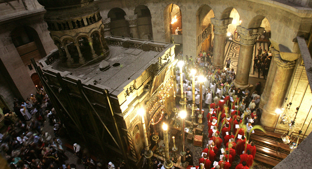 Christian clergymen holding Palm branches walk around the tomb of Jesus Christ during a mass to mark Palm Sunday in the Church of the Holy Sepulchre in Jerusalem's Old City. (File)