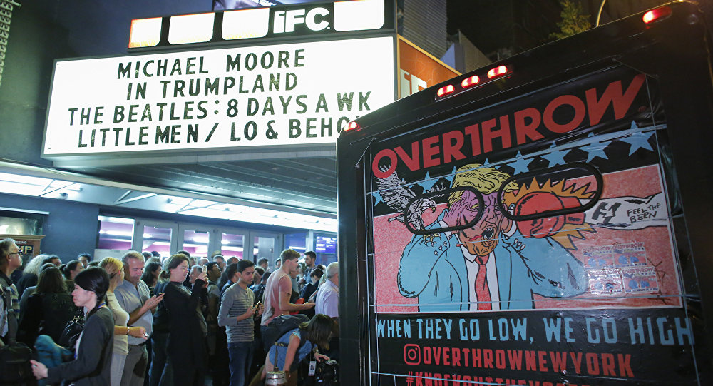 People wait in line outside the IFC Theater before the debut of a surprise documentary about Republican nominee Donald Trump titled TrumpLand by US filmmaker Michael Moore in New York on October 18, 2016