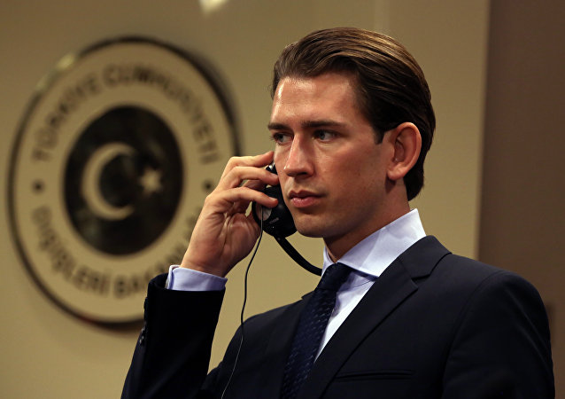 Austria's Foreign Minister Sebastian Kurz listens to his Turkish counterpart Feridun Sinirlioglu after talks in Ankara, Turkey, Saturday, Sept. 19, 2015