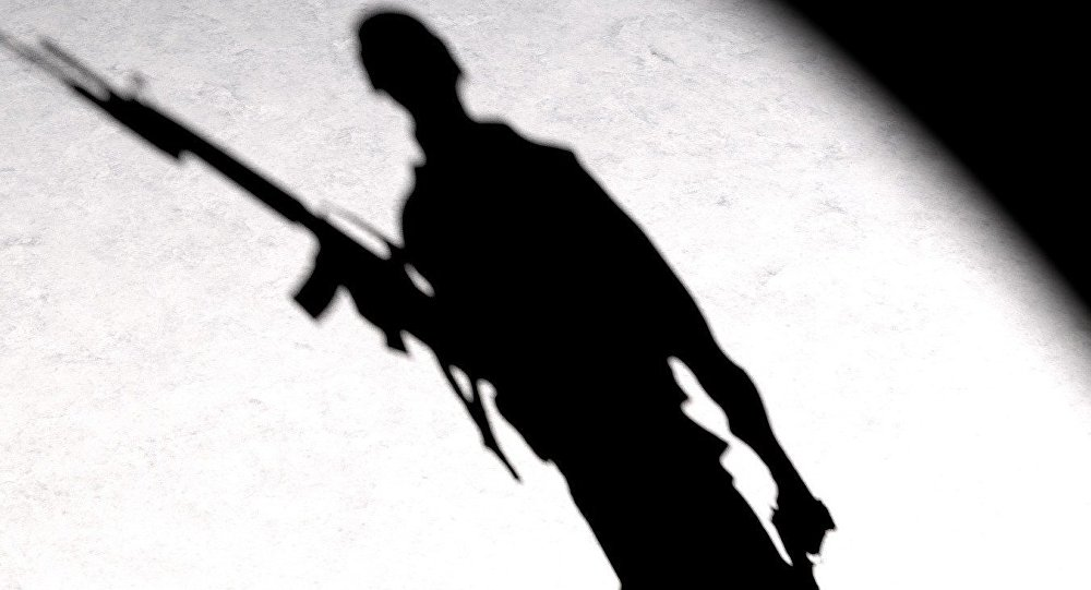 A silhouette of a man with a gun