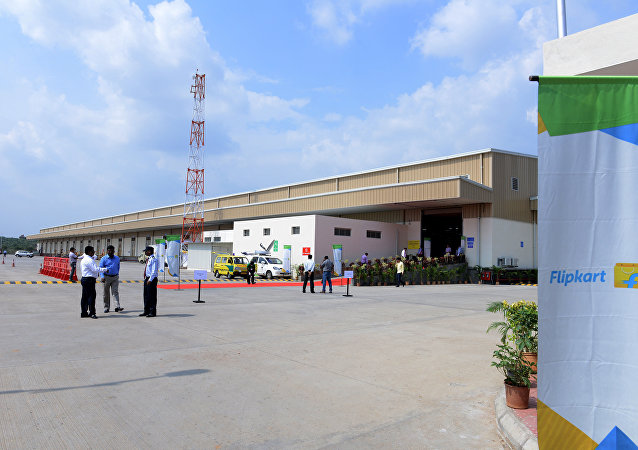 Indian security personel and officials wait at the launch of Flipkart's Largest Fulfillment Centre on the outskirts of Hyderabad (File)