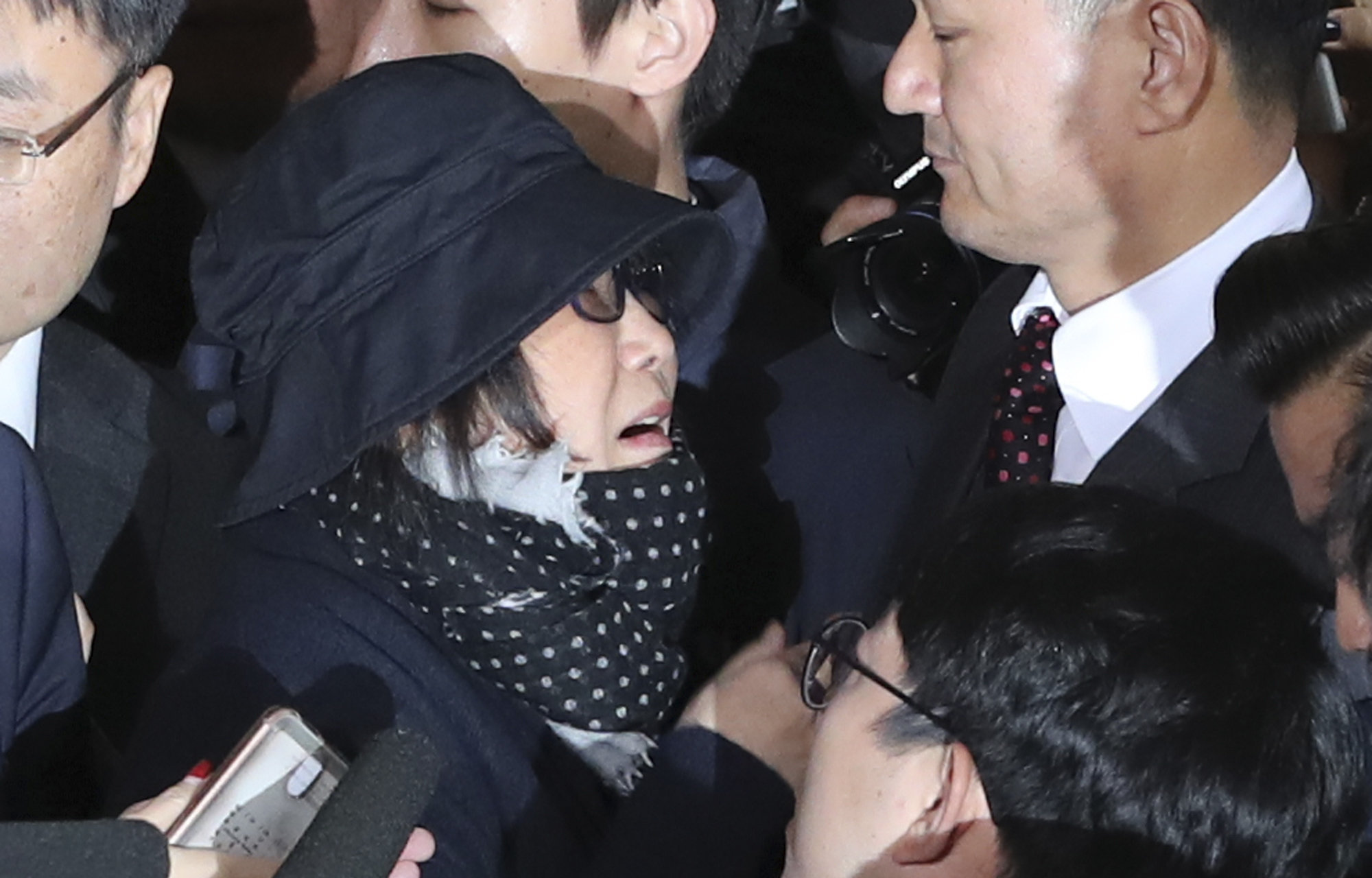 Choi Soon-sil, a cult leader's daughter with a decades-long connection to President Park Geun-hye, is surrounded by prosecutor's officers and media upon her arrival at the Seoul Central District Prosecutors' Office, Oct. 31, 2016