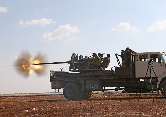 Fighters from the Free Syrian Army fire an anti-aircraft machine gun mounted on a vehicle deploy