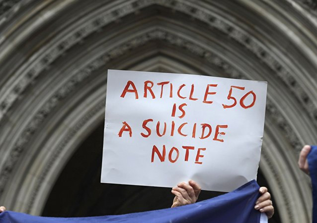 Article 50 of the EU's Lisbon Treaty that deals with the mechanism for departure is pictured with an EU flag following Britain's referendum results to leave the European Union, in this photo illustration taken in Brussels, Belgium, June 24, 2016